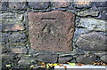 NX9821 : Benchmark on stone in wall on north side of the Ship Inn by Luke Shaw
