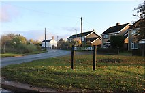 TL3776 : High Street at the junction of Earith Road, Colne by David Howard