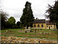 SP2032 : Trees in St David's churchyard, Moreton-in-Marsh by Jaggery