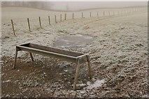 NS6378 : Feeding trough, Bencloich Farm by Richard Sutcliffe