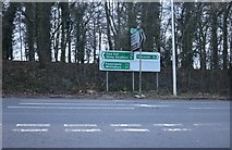 SP7047 : Direction signs on the A5, Towcester by David Howard