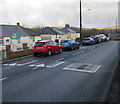 SN8007 : Three bumps/humps across the A4109 Dulais Road, Seven Sisters   by Jaggery