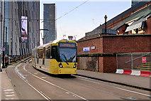 SJ8397 : Metrolink Tram passing Manchester Central by David Dixon