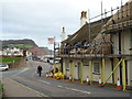 SY1287 : Sidmouth - thatchers at work by Chris Allen