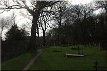 SD4161 : St Peter's church, path through graveyard by Robert Eva