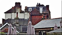 SU8605 : Two men on a roof - Chichester by Ian Cunliffe