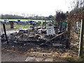 SU1789 : Vandalised beekeeper's hut, Stanton Park by Vieve Forward