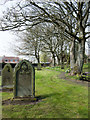 NZ1855 : Path among gravestones at churchyard in Tanfield by Trevor Littlewood