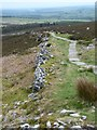 NZ0498 : Ancient wall and modern path by Russel Wills