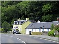 NN0561 : Cottages by the A82 by Steve Daniels