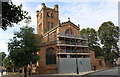 SP3379 : St John the Baptist's Church - Hiil Street face under repair by Roger Templeman