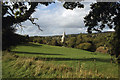 TQ0747 : Looking across field to St James's Church, Shere by Colin Park