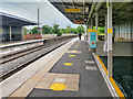 SD7807 : Social Distancing Markings at Radcliffe Metrolink Station by David Dixon