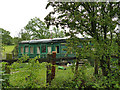 SE2647 : Old railway carriage at Newby House Farm by Stephen Craven