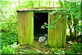 TL2554 : Cabin in Waresley Wood by Tiger