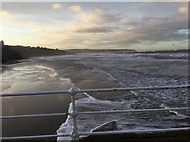 NZ8911 : A winter's evening on West Pier looking over the beach, Whitby by Rob Christopher