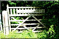 TL2554 : Memorial gate into Waresley Wood by Tiger