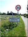 TG1418 : Swannington (Upgate) Village Name sign on School Road by Adrian Cable
