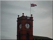 SO2956 : Flag on Kington Market Hall (Clock Tower) by Fabian Musto
