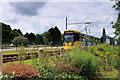 SJ8096 : Metrolink Tram on the Trafford Park Extension by David Dixon