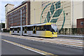 SJ8096 : Metrolink Tram at Trafford Wharf Road by David Dixon