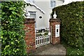 TL9559 : Drinkstone Green: Detached house with novel reuse of Victorian letter box by Michael Garlick