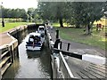 TL2470 : Two boats in the lock near Godmanchester by Richard Humphrey