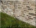 NY6758 : Methodist Church walls by Adrian Taylor