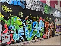 TQ5571 : Graffiti under M25 bridge next to the Darent Valley Path by Paul Williams