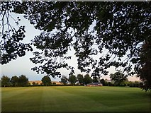 SU1069 : View over Avebury Cricket Ground at dusk by Brian Robert Marshall