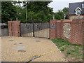 TF9305 : Gated entrance to dwellings by David Pashley