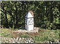 NY6621 : Old Milestone with modern plate by the A66, south east of Crackenthorpe by Terry Moore