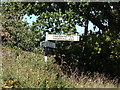 TG1219 : Signpost on Reepham Road by Adrian Cable