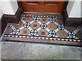 SH7882 : A tiled doorway on Mostyn Street, Llandudno by Meirion