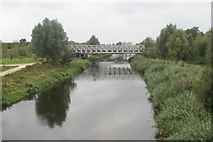TQ3785 : View of a cycle track crossing over the River Lea from a footbridge by Robert Lamb