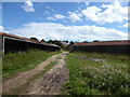 TM2538 : Disused farm buildings at Morston Hall by Chris Holifield