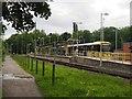 SJ8590 : East Didsbury tram stop by Graham Hogg