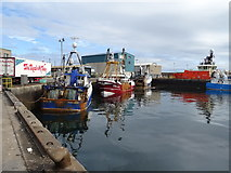 NJ9967 : Fishing boats, Fraserburgh Harbour by JThomas