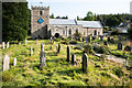 NY9939 : Graveyard at the church of St Thomas the Apostle by Trevor Littlewood
