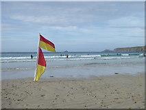 SW3526 : Safe bathing zone flags on Sennen beach by Rod Allday