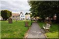 SE3263 : Graveyard at St Leonard's Church, Burton Leonard by Ian S