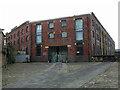 SE1416 : Railway warehouse, Huddersfield by Chris Allen