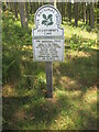 NU0535 : NT  sign  at  entrance  to  St  Cuthbert's  Cave  Wood by Martin Dawes