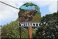 TM3679 : Wissett village sign (detail) by Adrian S Pye