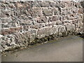 NY4726 : Sandstone outbuilding wall, Dalemain by Adrian Taylor