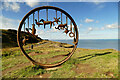 NZ6921 : Railway through sculpture by Andy Waddington