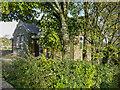 SE0341 : Laycock Village Hall, seen through trees by Humphrey Bolton