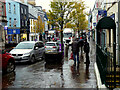 H4572 : A chat in the rain, Omagh by Kenneth  Allen