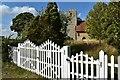 TM1453 : Churchyard gates, St. Gregory's Church, Hemingstone by Simon Mortimer