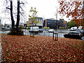 H4572 : Fallen leaves in front of South West College, Omagh by Kenneth  Allen